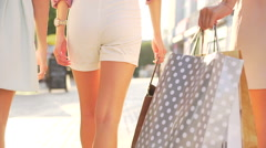 Shopping bags. Stylish women carrying full bags in hands. Sale concept. Tracking Stock Footage