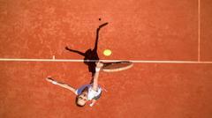 Tennis player hitting ball on tennis terrain Stock Photos