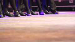 Two rows of women doing Irish dance with traditional step shoes Stock Footage