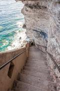 King Aragon stair steps in  Bonifacio cliff coast rocks, Corsica island, Fran Stock Photos