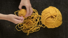 Clewing the yellow yarn up Stock Footage