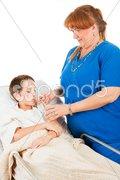 Nurse Administers Fluids Stock Photos