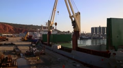 Crane dicharging Laura ship at port of Arzew Algeria March 2016 Stock Footage