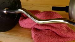 Weightlifting equipment, towel, water bottle. Stock Footage