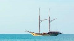 Wooden sailboat under bare poles - gaff topsail schooner Stock Footage
