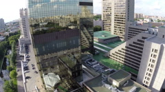 Airplane view on city reflection in mirror facade of building Stock Footage