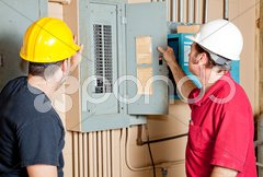 Repairmen Examine Electrical Panel Stock Photos