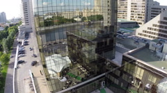 Aerial view of modern glassy building with city reflection. Moscow, Russia Stock Footage