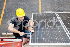 Solar Panel Repair with Copyspace Stock Photos