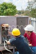 Air Conditioning Repair - Teamwork Stock Photos