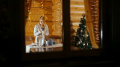 Young woman lighting a christmas candle Stock Footage