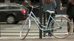 Bicycle tied to a pole. Stock Footage