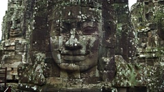 Large stone faces on the towers at The Bayon temple. Cambodia Stock Footage