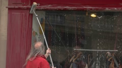 Man is cleaning storefront. Stock Footage