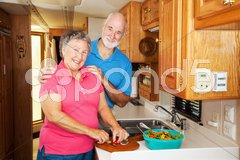 RV Seniors - Cooking Together Stock Photos