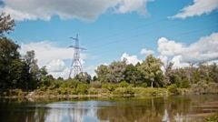 Wide shot timelapse of electricity power lines and high voltage pylons on a Stock Footage