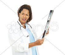 Confused Doctor With X-Ray Results Stock Photos
