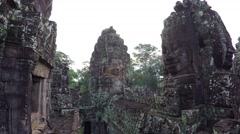 Ancient, Sculpted Stone Faces of Bayon Temple Ruin in Cambodia Stock Footage