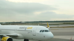 Airbus A320 from Vueling Airways waiting on tarmac Stock Footage