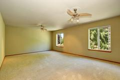Unfurnished room with carpet floor, two windows and lot of space. Northwest,  Stock Photos