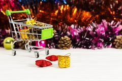 New Year Trolley with Christmas toys, buy a gift for the New Year Stock Photos