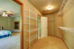 Empty walk through closet with shelves in the bedroom. Northwest, USA Stock Photos