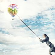 Woman catch balloon Stock Photos