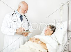 Doctor Reviews Medical History Stock Photos