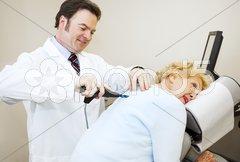Chiropractor Enjoys His Work Stock Photos