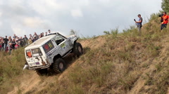 Car moves up the hill and use a winch. Stock Footage