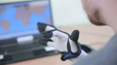 Electronic high-tech cyber glove. Man plays VR game operating with 3D bionic Stock Footage