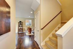 Hallway interior in soft beige colors and dark hardwood floors. Northwest, US Stock Photos