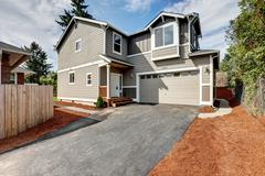 American gray house exterior with garage and driveway. Northwest, USA Stock Photos