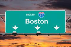 Interstate 95 North to Boston Highway Sign with Sunrise Sky Stock Photos