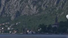 White cruise liner Norwegian Spirit leaving port of Kotor and cruising in Boka Stock Footage
