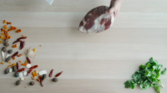 Raw Meat Slices Cutted On Wooden Board. Top View of Chefs Hands Chopping Beaf Stock Footage