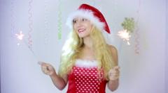 Santa claus girl holding sparklers burning. happy Santa girl in Christmas Stock Footage
