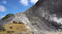 Panorama overview of active smoking Sibayak volcano. Establishing shot Stock Footage