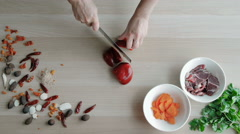 Female Hands Cutting Pepper, Making Salad. Top View Chief Cutting Vegetables Stock Footage