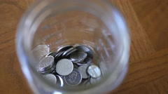 4K Pan over a Tip Jar With Coins Inside Stock Footage