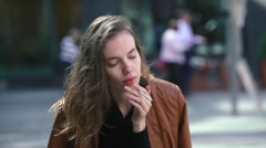 Sad depressed young woman smokes and coughs on the street Stock Footage