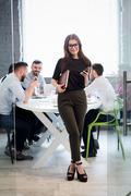 Businesswoman in office interior Stock Photos