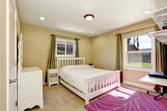 Nicely furnished bedroom in small American craftsman style home. Accent color Stock Photos