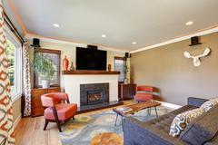 Open concept living room in American craftsman style house with beige walls,  Stock Photos