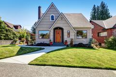 Small American craftsman one-story exterior with wood siding and concrete wal Stock Photos
