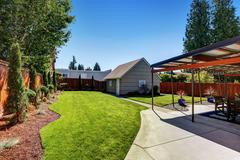 Backyard area with garage and perfectly trimmed garden. Northwest, USA Stock Photos