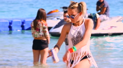 Young woman dancing on the electronic beach party by the sea Stock Footage