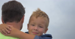 Father walks and keeps in arms his little son Stock Footage