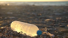 Environmental pollution with Plastic bottles at a coastline Stock Footage