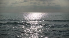 Sun Sparkles on Rippling Sea Waves at Noon. Slow motion Stock Footage